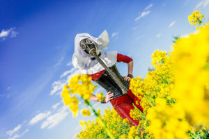 The Red Nun - A gasmasked trip into a colorfull canola field